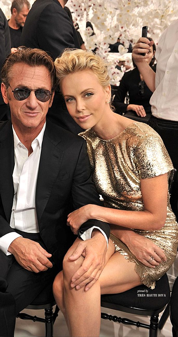 Sean Penn and Charlize Theron in the front row at the Christian Dior Autumn/Winter 2014-2015 Couture Show