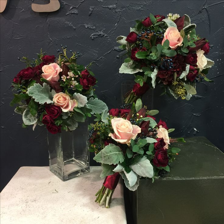 Beautiful Bridesmaid bouquet with red spray roses, Sweet Avalanche roses, amaryllis,viburnum berries, eucalyptus berries, veronica, silver leaves.
