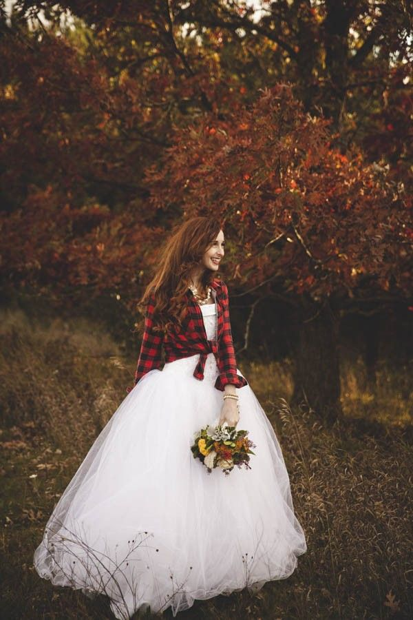 Lovely bride with rustic flannel jacket | Vintage Fall Wedding Inspiration via @junebugweddings, pics by CiogiArt Lifestyles Photography