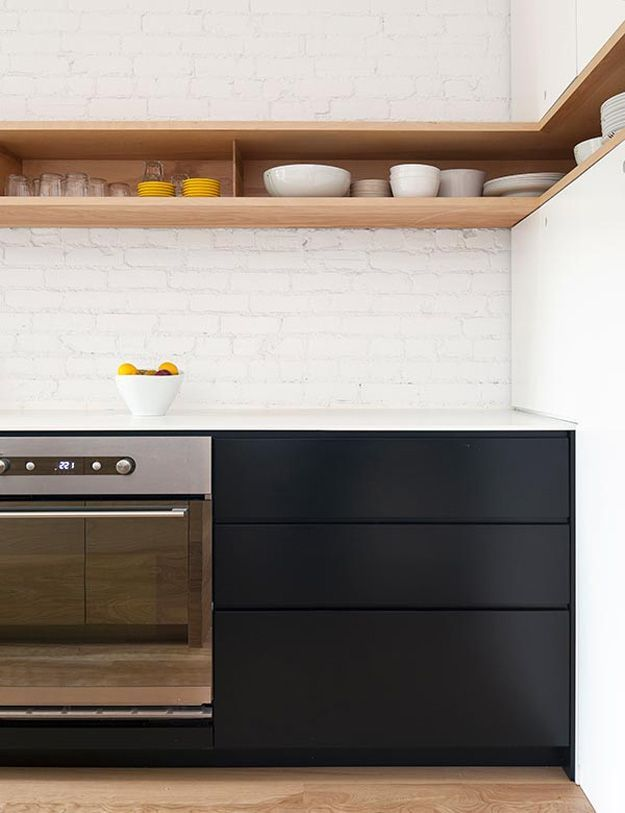 I love everything about this kitchen. The white painted brick wall, the matte black lower cabinets with white countertop (I despise my black quartz counters - I would totally swap for this combo), the