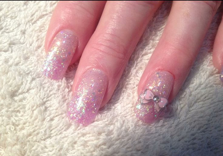 French Nails with pink glitter acrylic, glitter fade and cute pink bow.