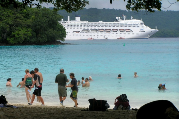 A cruise ship at Champagne Beach, Santo, Vanuatu. Locals capitalise on the tourism opportunities that cruise ship tours present to them.