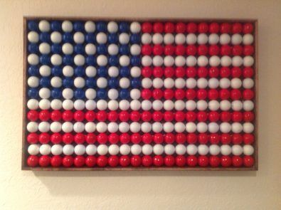 American flag made of painted golfballs  (35 blue) (35 white+40 white+60 white) (40 red+60 red)  (35 blue+135 white+100 red=260 total)