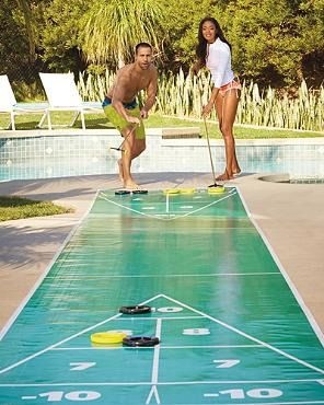 Frontgate 39 s portable shuffleboard set arrives with - Swimming pool games for two players ...