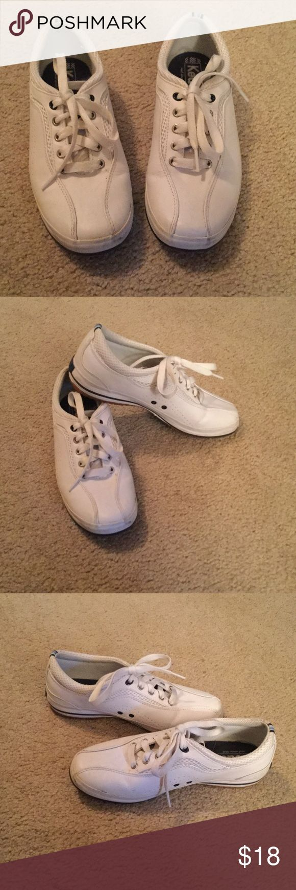 Keds White Sneakers Worn a few times, but good condition.  Cushioned insoles. White trimmed with navy blue. Keds Shoes Sneakers