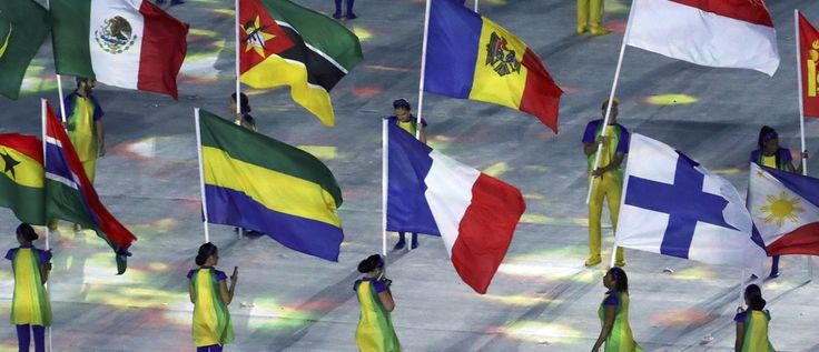 2016 Rio Olympics - Closing Ceremony - Maracana - Rio de Janeiro, Brazil - 21/08/2016. Volunteers hold flags of different countries, including France and Mexico.     REUTERS/Yves Herman FOR EDITORIAL USE ONLY. NOT FOR SALE FOR MARKETING OR ADVERTISING CAMPAIGNS.   - RTX2MGHB