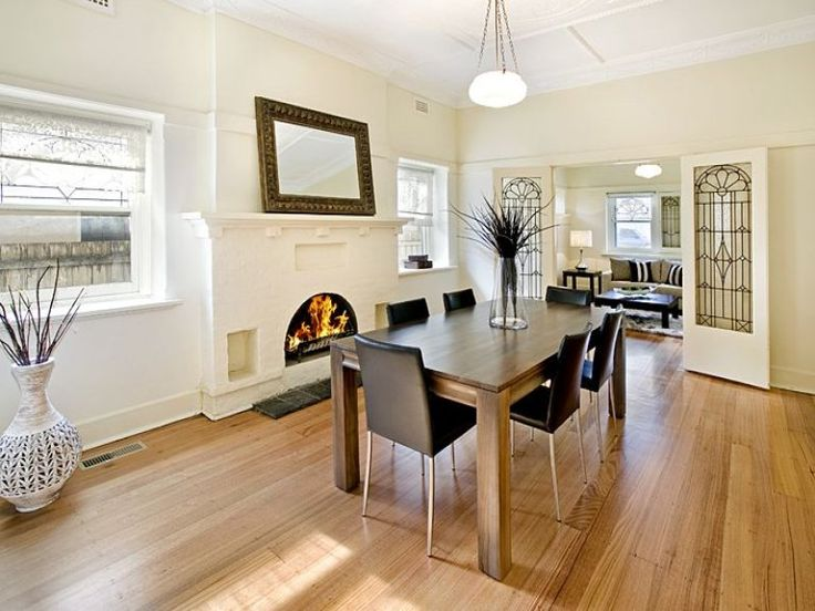 art deco dining room idea with floorboards and bay windows