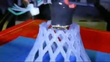 "Timelapse video of a hyperboloid object print (made of PLA) using a RepRap ""Prusa Mendel"" 3D printer for molten polymer deposition"
