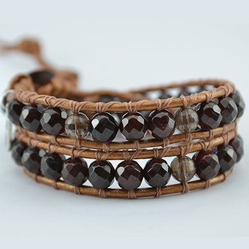 Our Devotion wrap bracelet has been designed with Garnet and Smokey Quartz Gemstones. Created to promote its wearer's flow of loving energy and vitality. Garnet is the stone of Health and Life Force.  On copper genuine leather (or vegan alternative*), finished with a unique copper button clasp. Can be purchased in two optional sizes for men or women, 2 wrap and 3 wrap, each wrap bracelet with 3 adjustable closures.  *If you prefer our vegan cord…