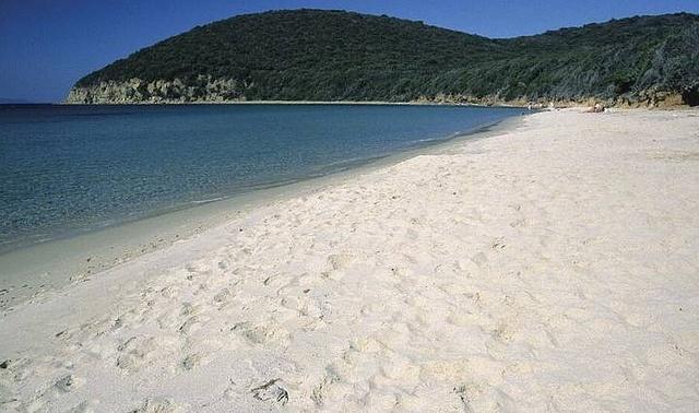 Cala Violina, the beach where the sand makes sound like a violin! Gavorrano, Maremma, Tuscany, Italy