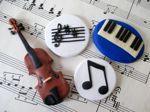 Music Magnets - so pretty!   Fridge magnets including a miniature violin, piano keyboard and treble clef, all made from polymer clay.  My favorite is the violin, made to scale.  I hope there will be other musical instruments - so beautifully handmade.