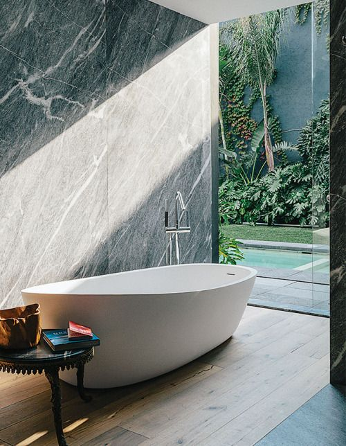 We love the attention to detail and tones used throughout this home in Mexico. The striking master bathroom features a silvery grey marble which really complements the wooden accents.