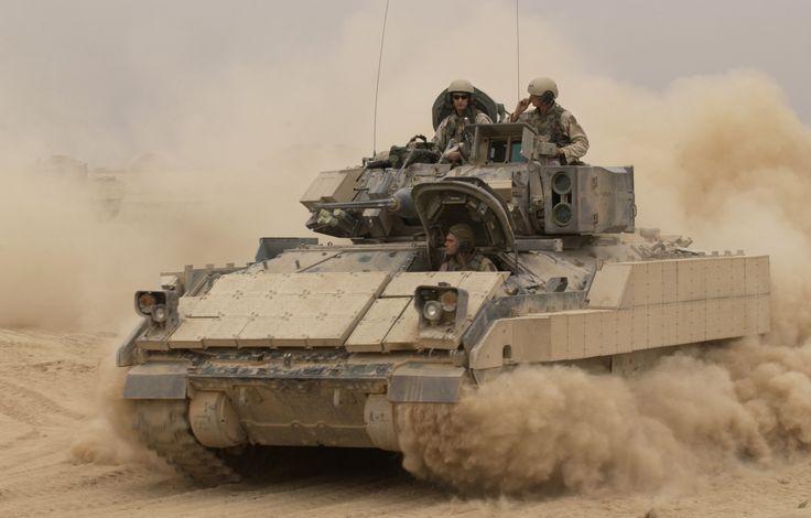 M2a2 bradley fighting vehicle kicks up plumes of dust as it leaves ...