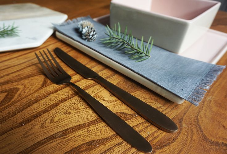 Super special copper cutlery by Bloomingville. Rose pink contemporary dinnerware also by Bloomingville.