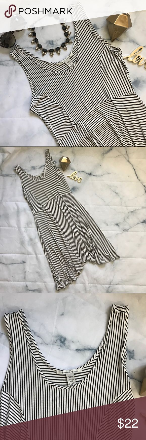 American Rag Striped Dress Super soft black and white striped dress with shark bite hemline. This would be so cute with a jean jacket, your favorite sunnies and some flats or sneaks. Casual weekend, brunch with friends, day date, very versatile. EUC     No visible signs of rips, stains or damage.         🖤🖤No trades, No modeling🖤🖤                         Pet friendly home. American Rag Dresses