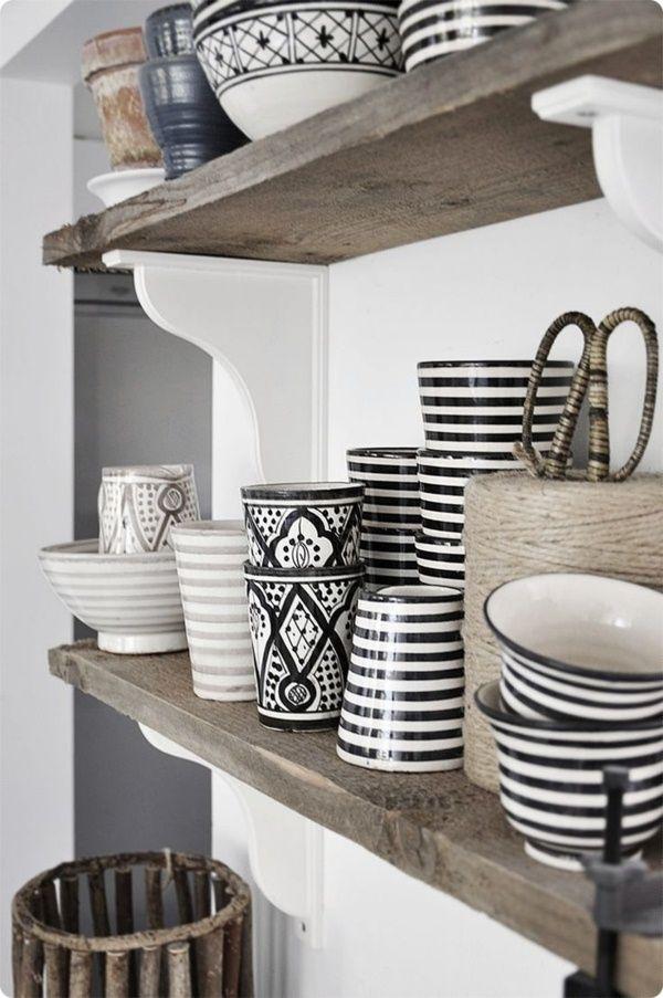 Raw wood shelf with painted wood brackets