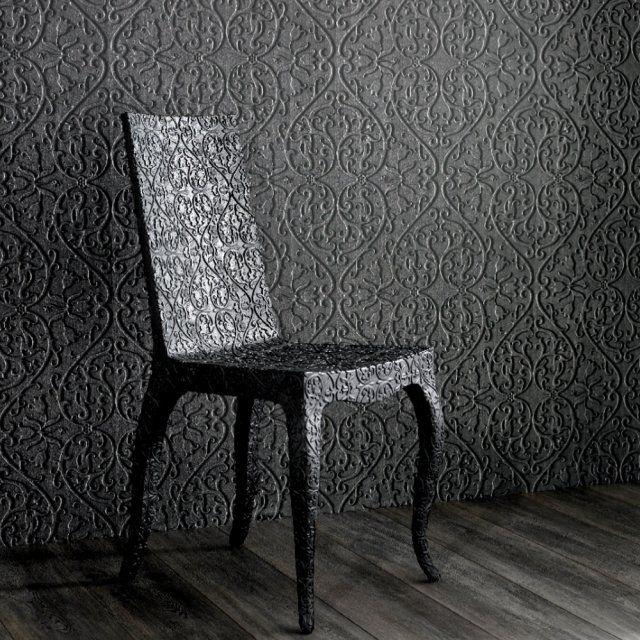 <p>Voici la preuve que le papier peint noir n'est pas triste, surtout lorsqu'il crée des effets de matière. En impression relief, le papier peint laisse la lumière se...