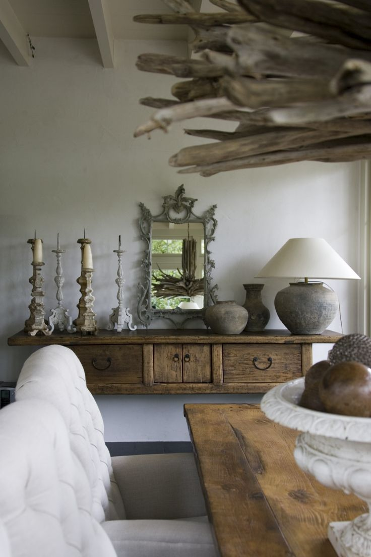 .Love that wooden cabinet (?) along wall, the natural materials and the white...
