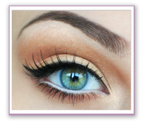"""Stunning, but simple. White eyeliner along the water line, making sure to properly cover both ends; close your eyes and run the white eyeliner inside (covering both top & bottom waterline) non-shimmer gold eyeshadow along the lid; copper shadow along the crease and slightly above; a """"highlighting"""" color along the brown bone. Finish with a cat eye flick w/ liquid eyeliner, mascara and a bomb eyebrow shape. Done in mere minutes."""