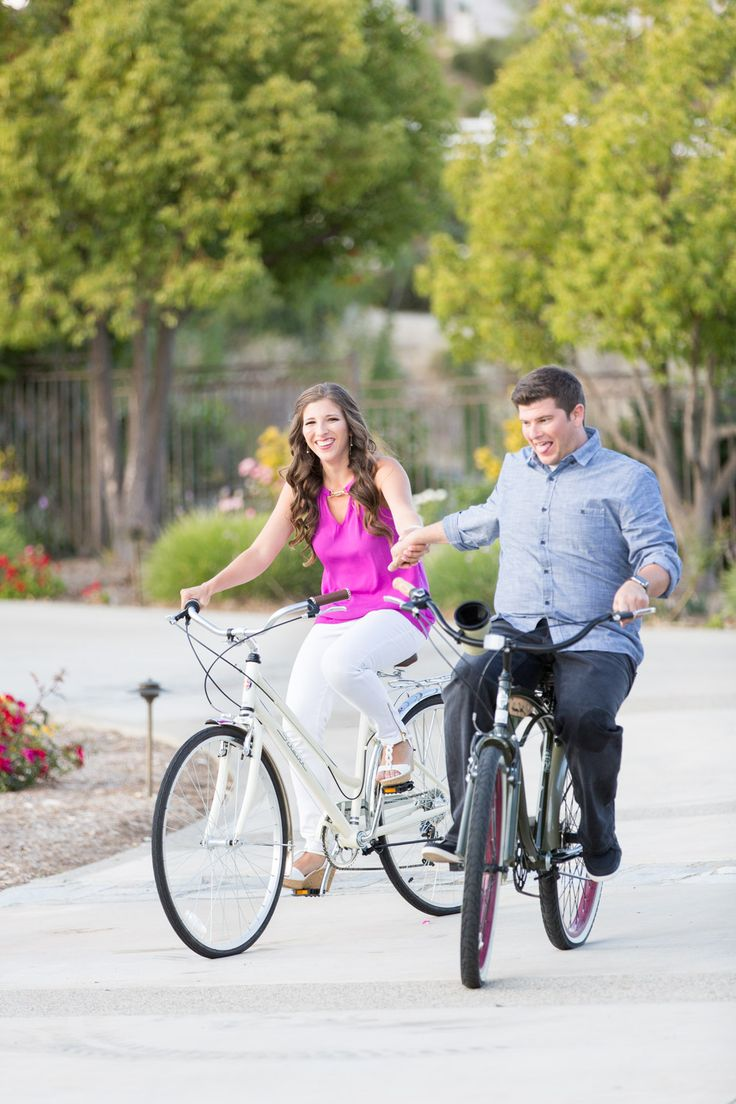 Cute couple riding bikes for their engagement session photos by Cavin Elizabeth Photography