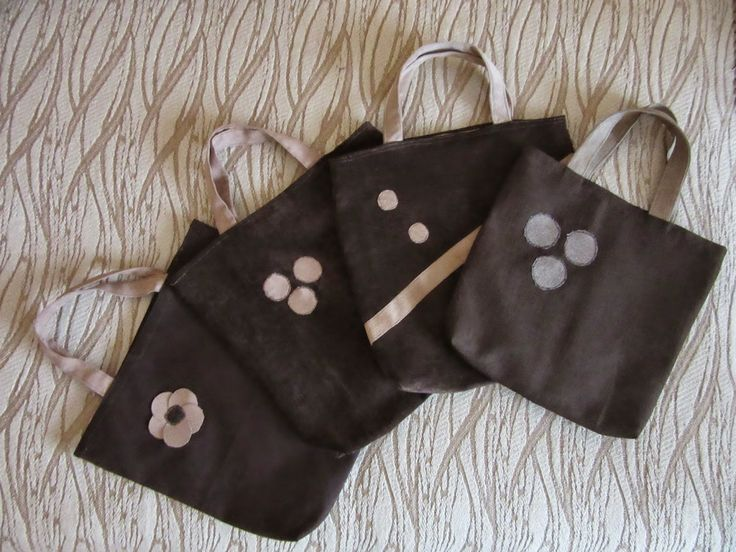 Brown tote bags with bright applications.