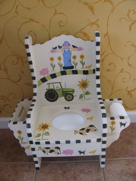 I need to find one like this with monkeys for Max!  And a pink one for Clare! :-) Children's Potty Chair  Magazine Rack & Toilet Roll by bubee, $75.00