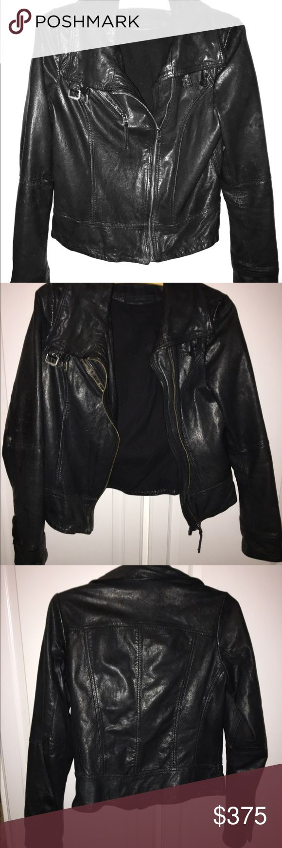Genuine ALL SAINTS Black Leather Jacket Genuine ALL SAINTS Spitafields Black Leather jacket. Off center cross zipper and zippered front breast pocket. Tailored fit. Double snaps at end of sleeves. Double buckles at neck for optional full closure. Leather has slight sheen.✨ Label says size 10 but fits EXACTLY like a size 6 (USA). Worn once for promotional purposes.                                               Reasonable offers only please. All Saints Jackets & Coats