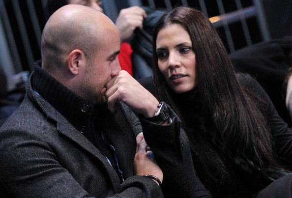 Pepe Reina Photos Photos - Pepe Reina, goalkeeper of Spain and Liverpool, and his wife Yolanda Ruiz Reina cheering for Rafael Nadal during his match against Roger Federer. Despite their support, Nadal lost in straight sets, at the 2011 Barclays ATP World Tour Finals held at the O2 Arena in London. - Pepe Reina at a Tennis Match