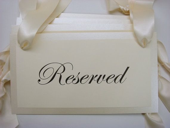 Reserved wedding ceremony pew signs for your family seating during your wedding ceremony and reception. These Shabby Chic reserved signs are perfect for you if you know you need to reserve seating for your ceremony or reception, but do not want to designate a family side for seating. These signs say simply Reserved.  Price: $9.00 each.  Dimensions: 6.00 inches tall x 11.00 inches long  Wording: The wording for the sign is Reserved. Ribbon: 1.5 inch wide double sided satin ribbon. The ribbon…