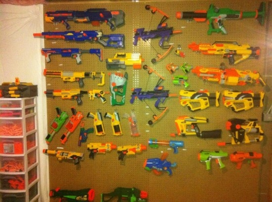 Way too many nerf guns--pegboard, even the Vulcan