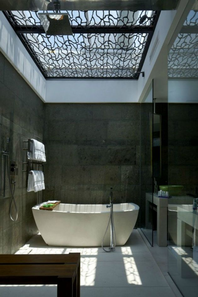 Stylish bathroom with a screened skylight, which provides visual texture.