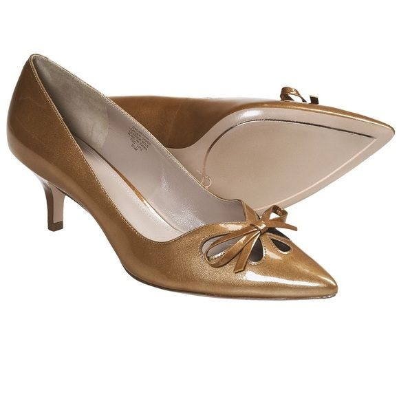 """Joan & David Gardner Pumps 7.5 M Gold Patent """"Wear on sole and heel. Comes in original box with dust bag."""" Chic and fashionable, Joan & David's Gardner pumps feature pretty teardrop cutouts and a dainty bow over the instep, complete with a stylish pointed toe and kitten heel. Joan & David is an international trend-setting brand employing high-quality materials and excellent craftsmanship Shimmery patent leather Teardrop cutouts with bow Kitten heel Joan & David Shoes Heels"""