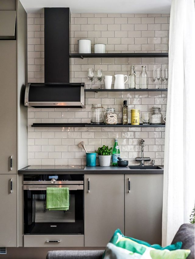 Black open shelving with white subway tiles