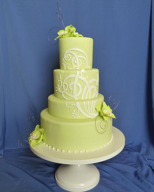 I love the one huge multi-layer design, maybe our monogram? green orchid wedding cake