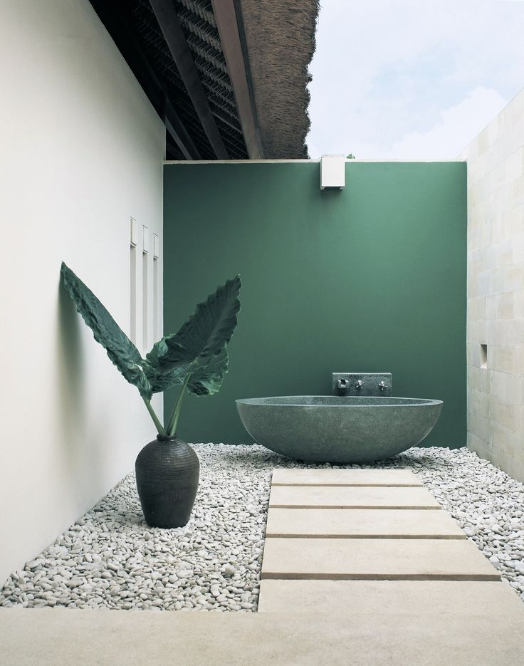 Outdoor marble bath, emerald green wall and pebbles. Great Lakes Stoneworks is an area of  finest granite marble.