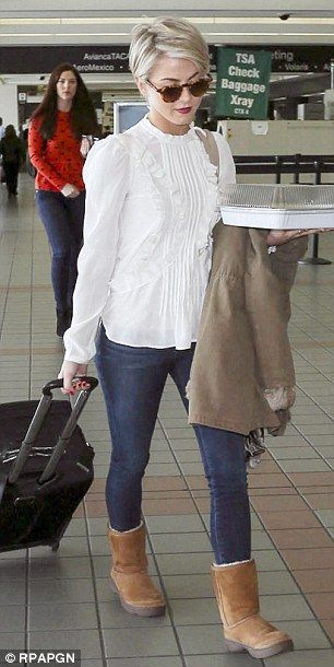 Glowing! Julianne's glossy new locks lit up the airport
