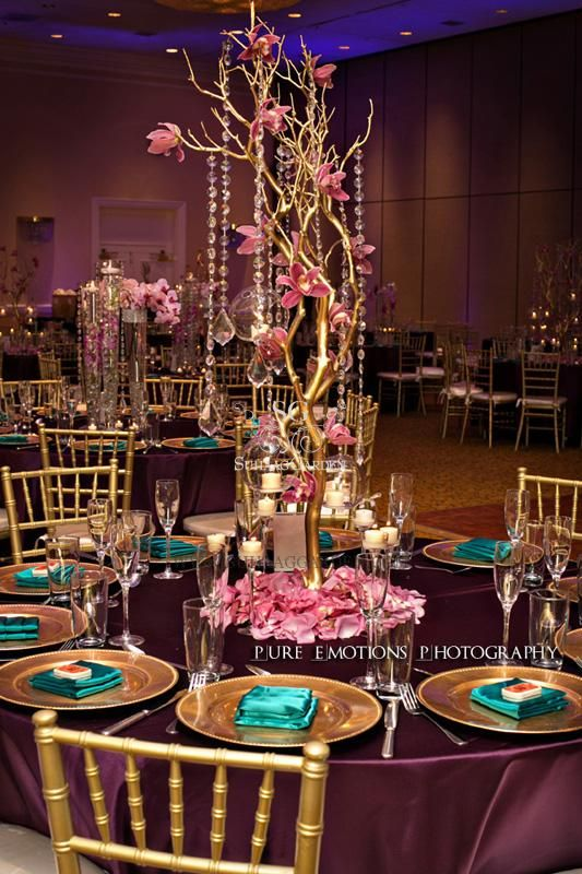 Centerpieces--metalic painted tree with crystals and fresh flowers