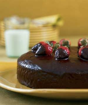 This recipe makes the thickest, fluffiest chocolate cake I've ever had. I skip the icing and strawberries on top and instead drizzle caramel sauce over the cake and serve it with ice cream.