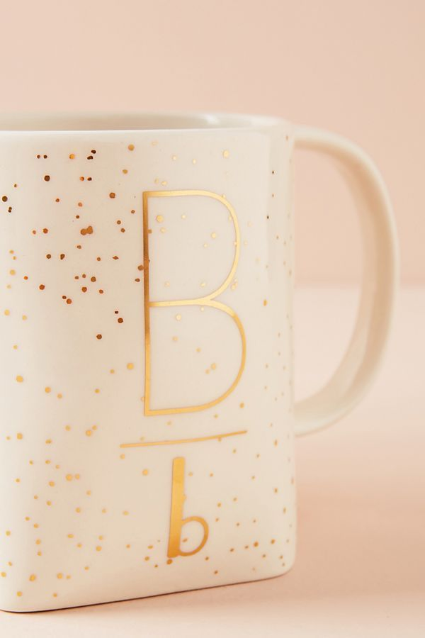 Pretty gilded shapes monogram coffee mug from Anthropologie. Stoneware. White with gold details. Hand wash. Holds 16 oz. Measures 4 inches high by 3.5 inches in diameter. #coffeemugs #monogram #golden
