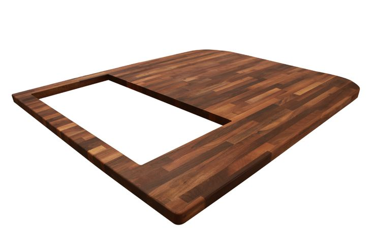 This bespoke walnut worktop was created especially for a worktop island, and features a pencil edge profile around the entire circumference. Radius corners create a smooth edge on two of the corners, with a double-width hob cut out completing the worktop: http://www.worktop-express.co.uk/wood_worktops/walnut_worktops.html