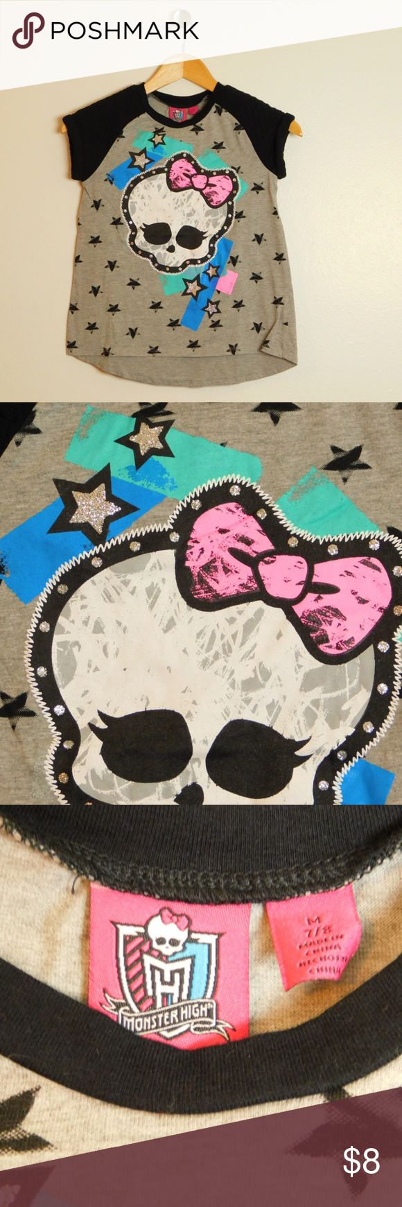 Monster High Girls Skull Graphic Tee size 7/8 EUC Monster High Children's kids size 7/8 GUC Gently Used Condition, no stains, holes  Crew neckline Rolled cuff short sleeve, quilted Glitter skull graphic at front Rounded hem Cotton/polyester Machine washable monster high Shirts & Tops Tees - Short Sleeve