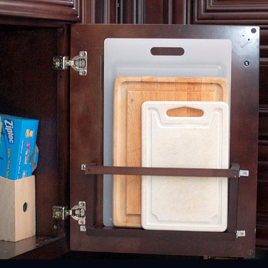 DIY project for improvising a cutting board holder that hides behind a base cabinet door.