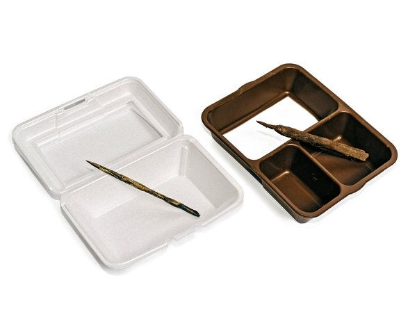 A traditional Styrofoam serving tray and a safer JonesZylon serving tray, with weapons made from them. The New York Times
