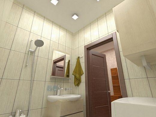 В ванной же комнате имеется ванна, умывальник с тумбочкой, установлена стиральная машина. Для облицовки стен выбрана классическая вертикальная керамическая плитка бежевого цвета.