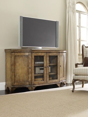 Two doors with two adjustable shelves behind each door; two wood-framed doors with chicken wire and two adjustable shelves behind; one three plug electrical outlet.  Will accommodate most 65-inch and some 70-inch televisions. www.amhomefurnishings.com