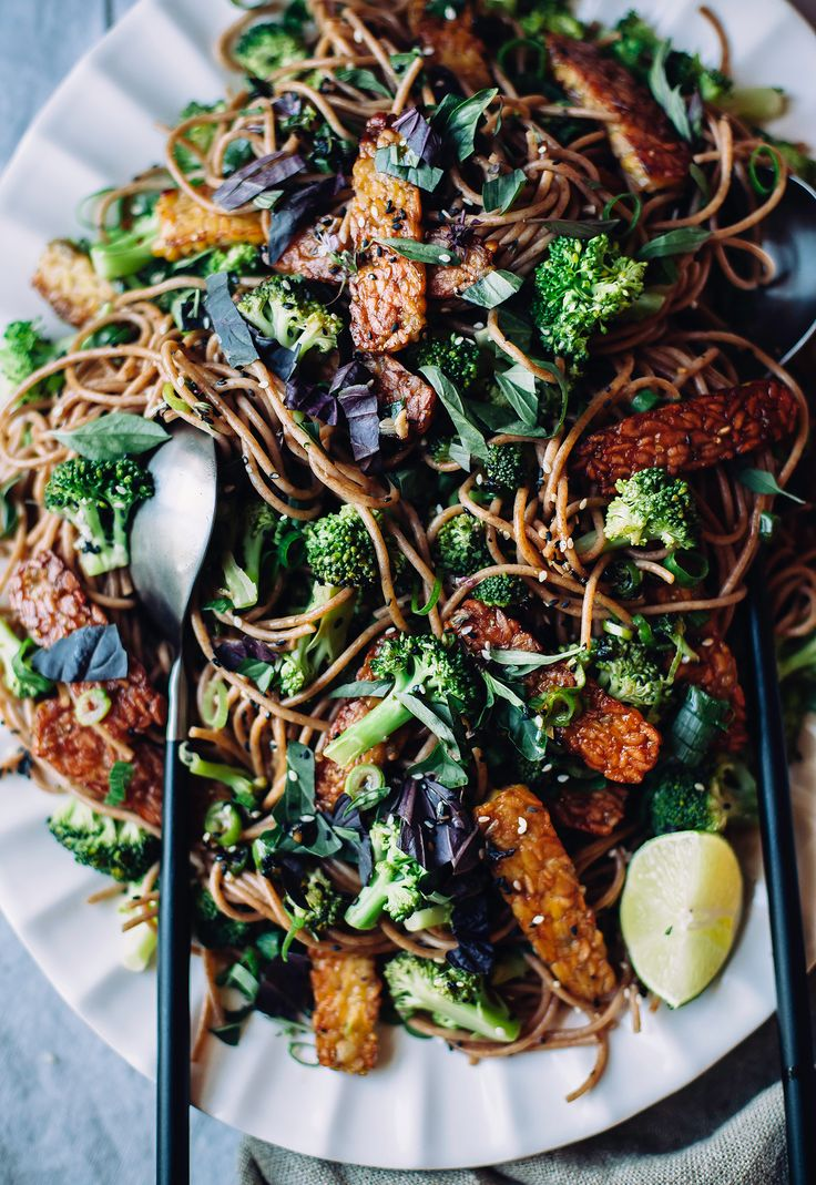 Sesame garlic noodles are an easy and delicious vegan main that's ready in 25 minutes. Saucy noodles, fresh vegetables, and golden brown tempeh for protein.