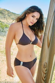 Stunning! Kelly Brook smoulders as she showcases her ample assets in a chocolate coloured ...