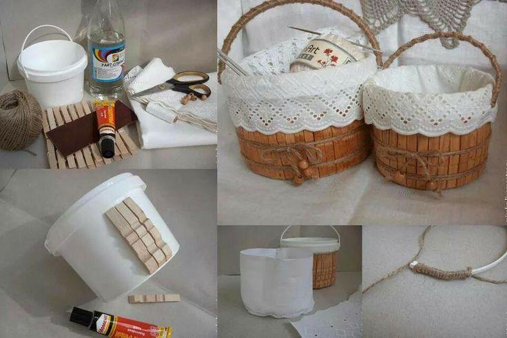 Cestos con botes de pintura y pinzas de la ropa