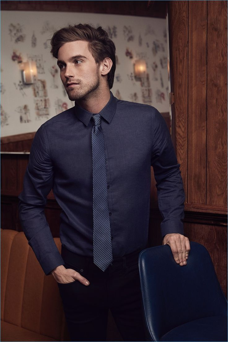 American model RJ King showcases one of Express' smart shirt and tie combos.