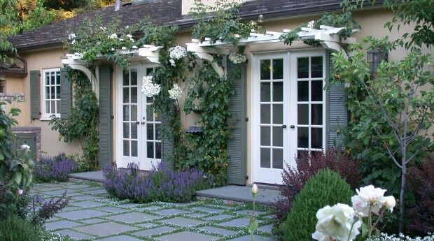 Little arbors over the french doors.